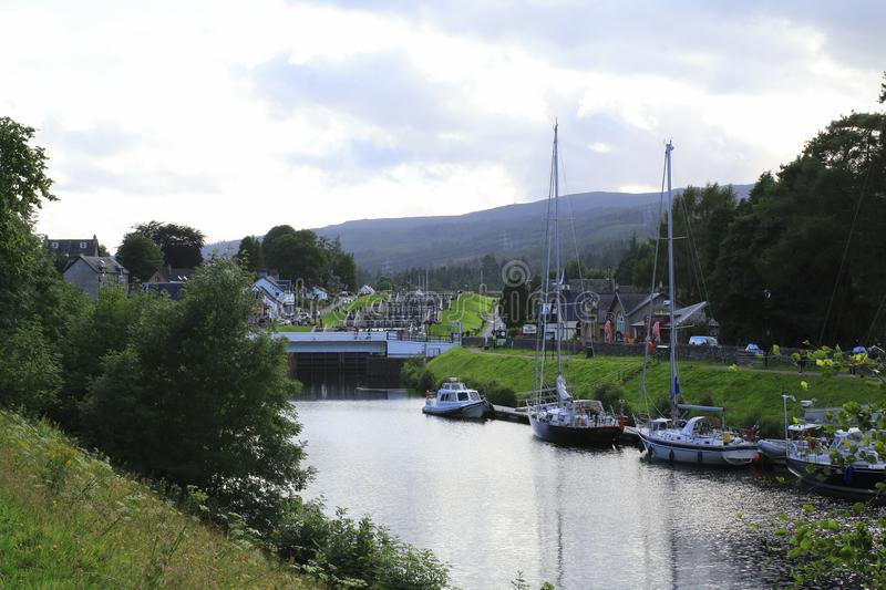 Kaledonischer, Caledonian canal with ships and watergate, in Scottish highlands at Loch Ness. Kaledonischer, Caledonian canal with ships and watergate, promenade royalty free stock photography