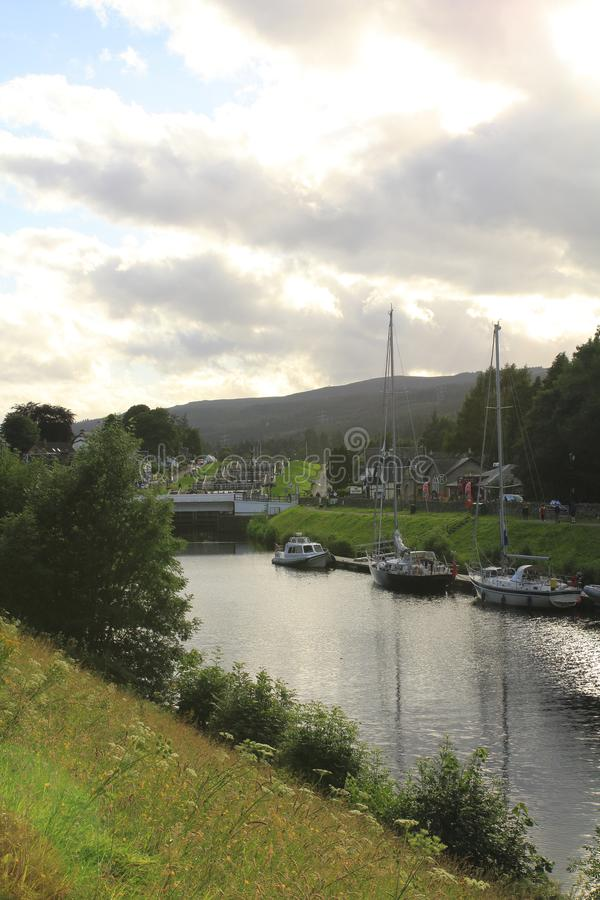 Kaledonischer, Caledonian canal with ships and watergate, in Scottish highlands at Loch Ness. Kaledonischer, caledonischer canal with ships and watergate royalty free stock photos