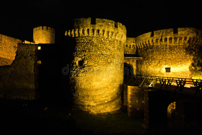 Kalemegdan fortress wooden bridge, gates and towers at night in Belgrade stock images