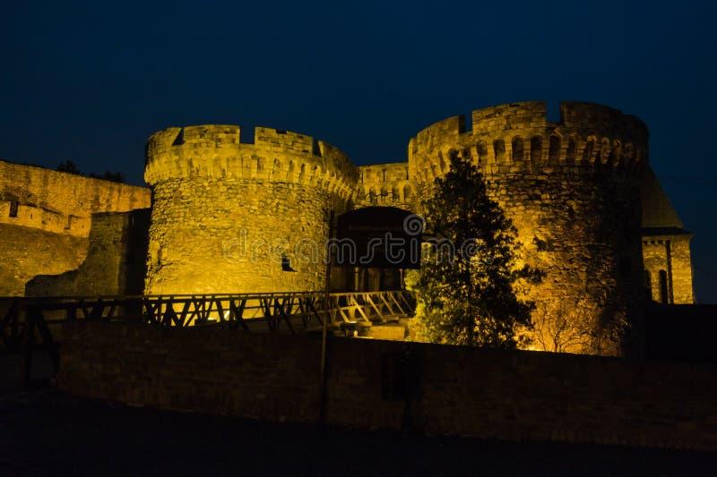 Kalemegdan fortress wooden bridge, gates and towers at twilight in Belgrade royalty free stock photos