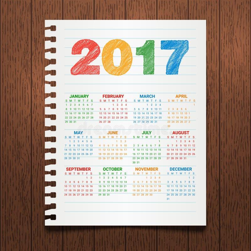 Kalender för 2017 år på en mörk träbakgrund Hand dragen färgrik text Pappers- anteckningsbok Orientering för företags affär royaltyfri illustrationer