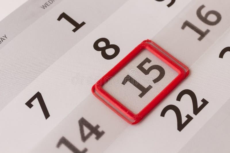 Kalender: numret 15 markeras med den röda gränsen royaltyfri fotografi