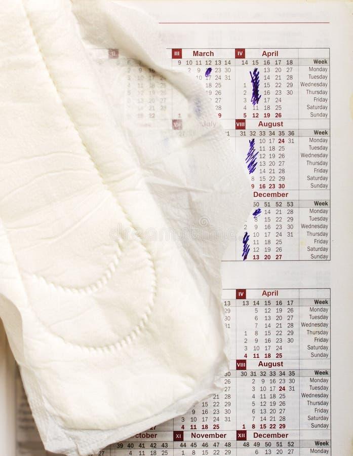 Kalender och sanitetsbinda royaltyfri foto
