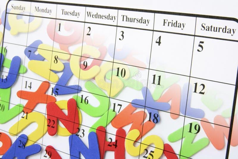 Kalender-Seite und Alphabete lizenzfreie stockbilder