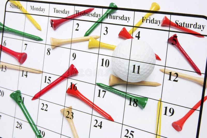 Kalender-und Golf-T-Stücke lizenzfreie stockfotos
