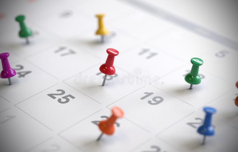 Kalenderseite mit Zeichnungstiften, stockbild