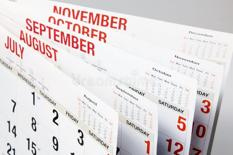 Kalendersidor arkivfoto