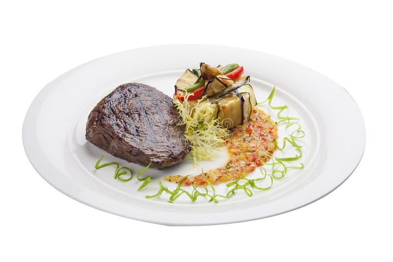 Kalfsvleeslapje vlees met salsa op een witte plaat royalty-vrije stock foto's