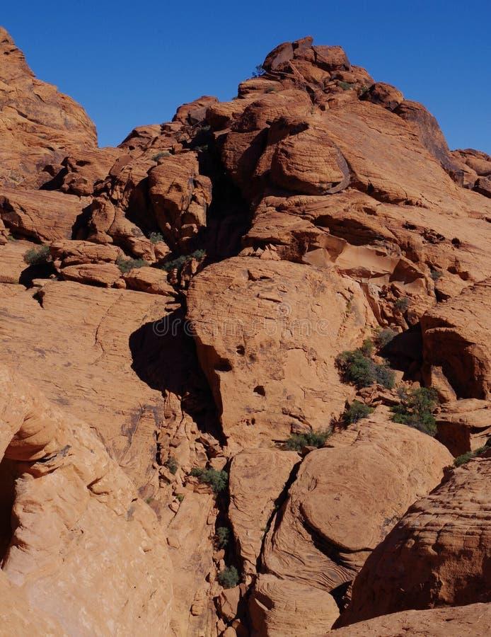 Kalikåkullar som är röda vaggar naturvårdsområde, sydliga Nevada, USA royaltyfria foton