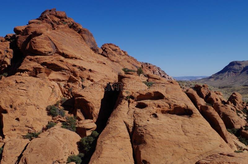 Kalikåkullar som är röda vaggar naturvårdsområde, sydliga Nevada, USA royaltyfria bilder