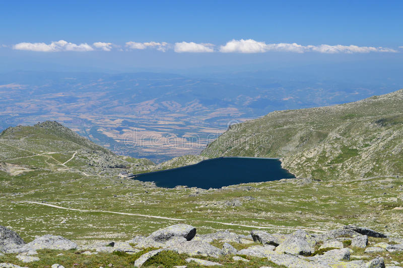 Kalin - the highest mountain dam lake on the Balkans. Kalin - the highest dam lake on the Balkans situated at 2394 m altitude in Rila Mountain, Bulgaria. The stock images