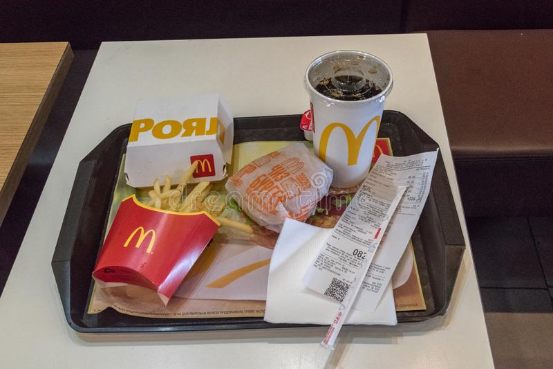 Mcdonald`s Royal with bacon burger sandwich, french fries, cheeseburger and cup of Coca-Cola for drink stock photo