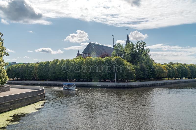 Pregolya river in the Kaliningrad city, Russian Federation. Kaliningrad, Russia - August 4, 2019: Pregolya river in the Kaliningrad city, Russian Federation stock images