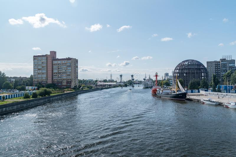 Pregolya river with ships in the Kaliningrad city, Russian Federation. Kaliningrad, Russia - August 4, 2019: Pregolya river with ships in the Kaliningrad city stock photography