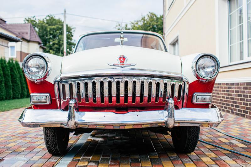 Kaliningrad, Russia - August 22, 2019. Retro car GAZ-21 Volga color white and red parcked near a house stock photos