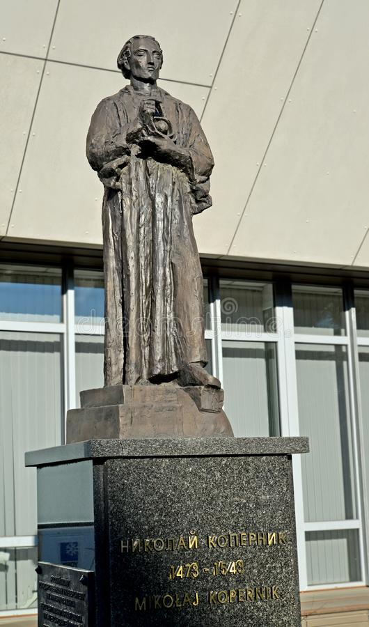 KALININGRAD, RUSSIA. Nicolaus Copernicus`s sculpture against the background of the university building. The Russian and Polish tex stock photo