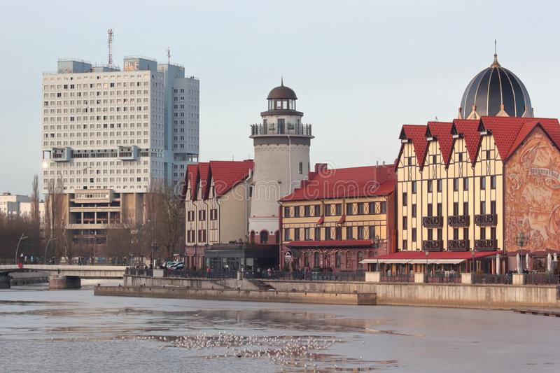 Kaliningrad, Russia - February 10, 2019: Old and modern buildings near the frozen river. Walking at the street and find different buildings at the pedestrian royalty free stock images