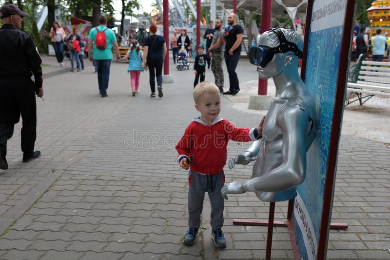 Kaliningrad, Russia - June 01, 2019: Little boy touching dummy at city park royalty free stock image
