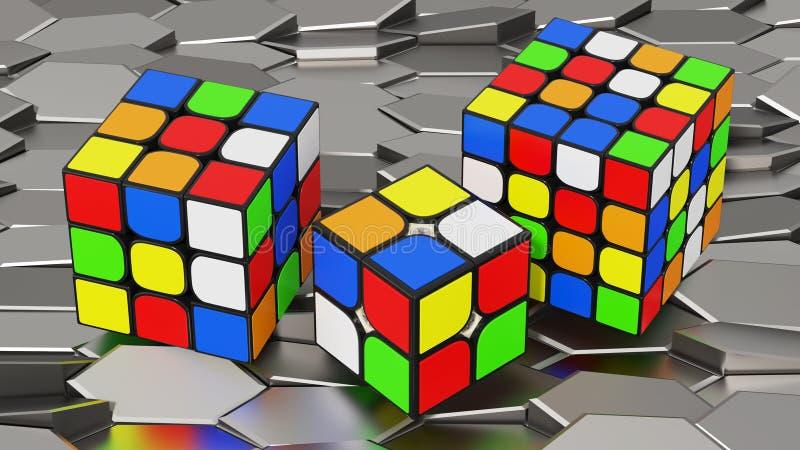 Three Rubiks cubes. Three different size Rubik's cubes