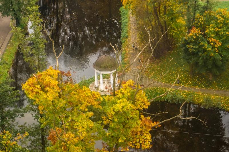 Top view of the gazebo next to the pond in the Park. stock image