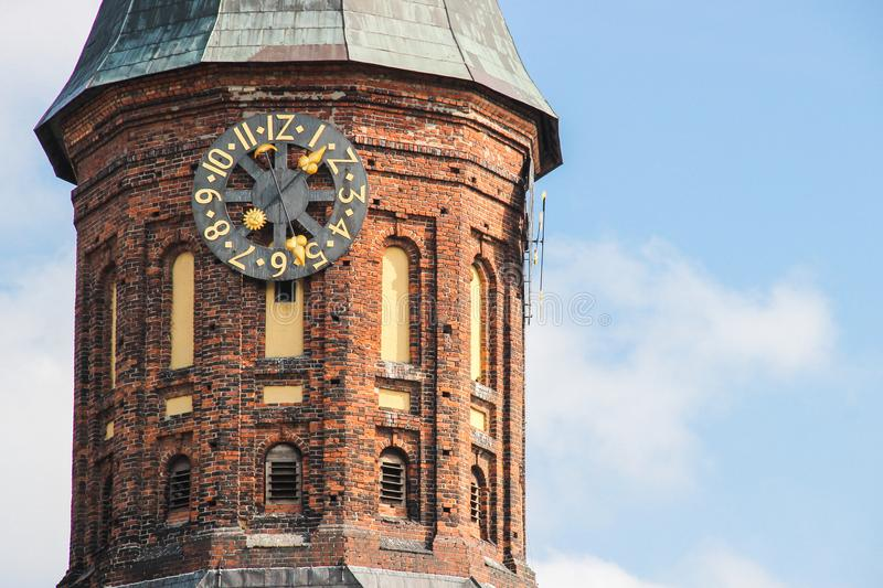 Kaliningrad, RUSSIA - SEPTEMBER 14, 2015: Cathedral of Kant in Kaliningrad. Photo of the clock in medieval style royalty free stock image