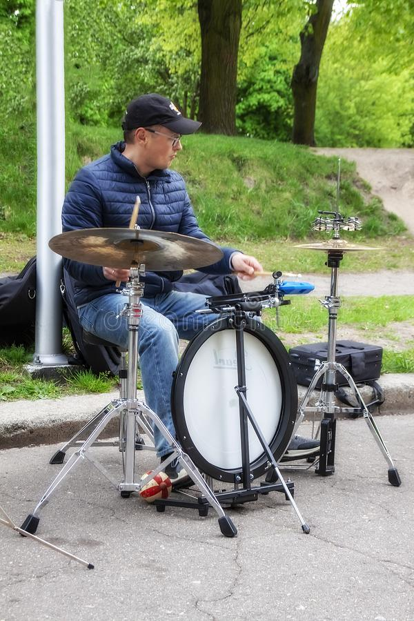 Kaliningrad Russia 05.01.2019 Street musician plays the melody on the drums stock image