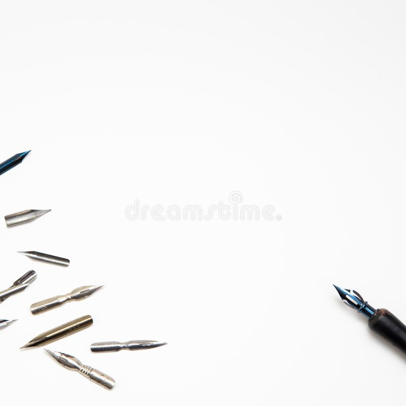 Kaliograph workplace. Calligraphy pens and pen on a white background. top view. close-up, mockup. Kaliograph workplace. Calligraphy pens and pen on a white royalty free stock photography