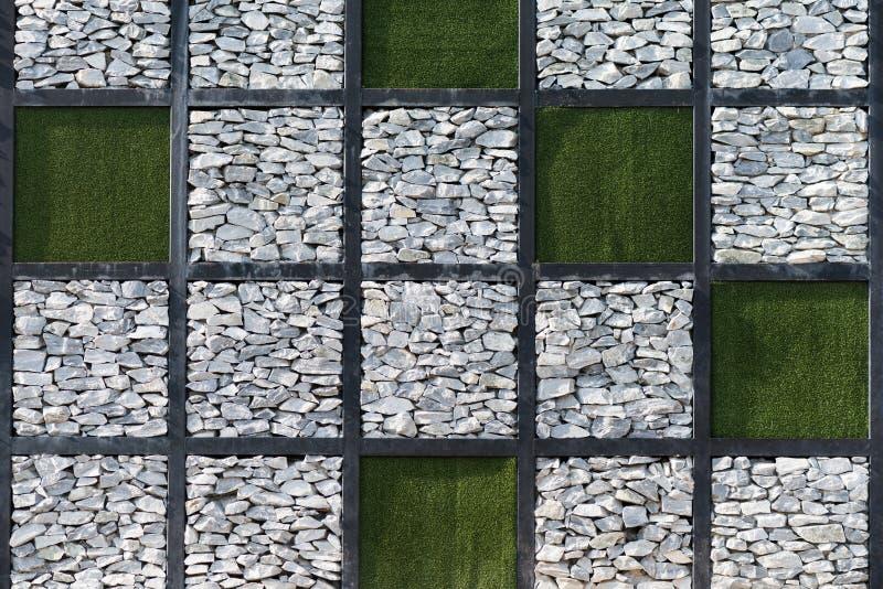Kalksteen en Kunstmatige grasachtergrond stock fotografie