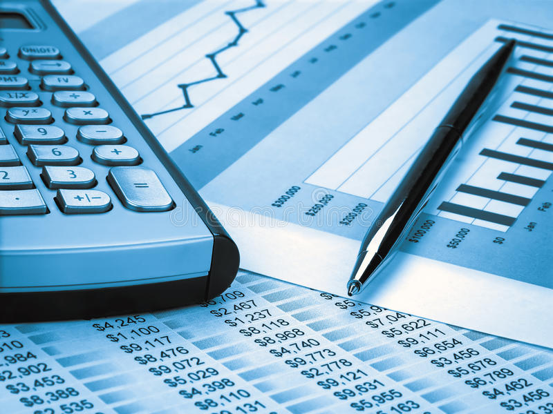Kalkulator i pióro zdjęcie stock