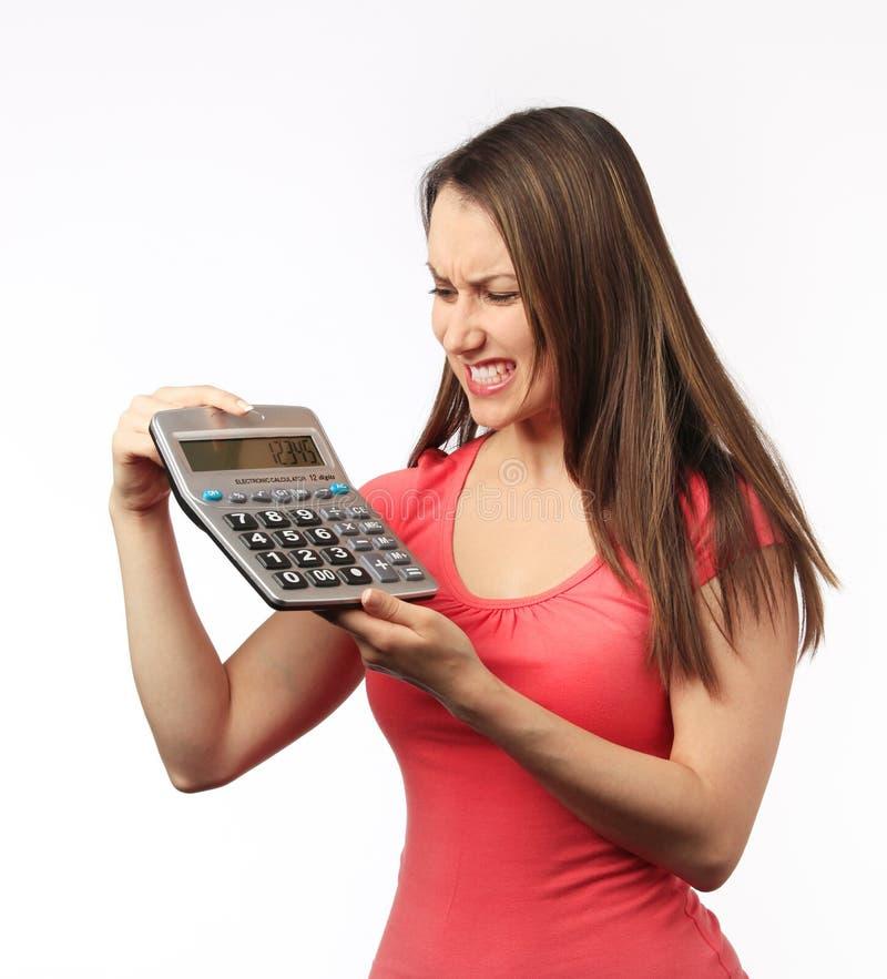 kalkulatora mienia kobiety potomstwa zdjęcia stock
