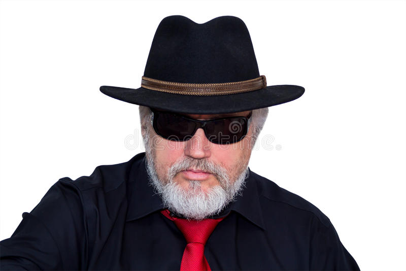 Kall pensionär med hatten och slipsen arkivfoto