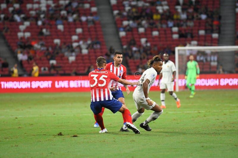 Kallang-Singapore-30Jul2018: Christopher-nkunku 24 speler van PSG stock afbeelding