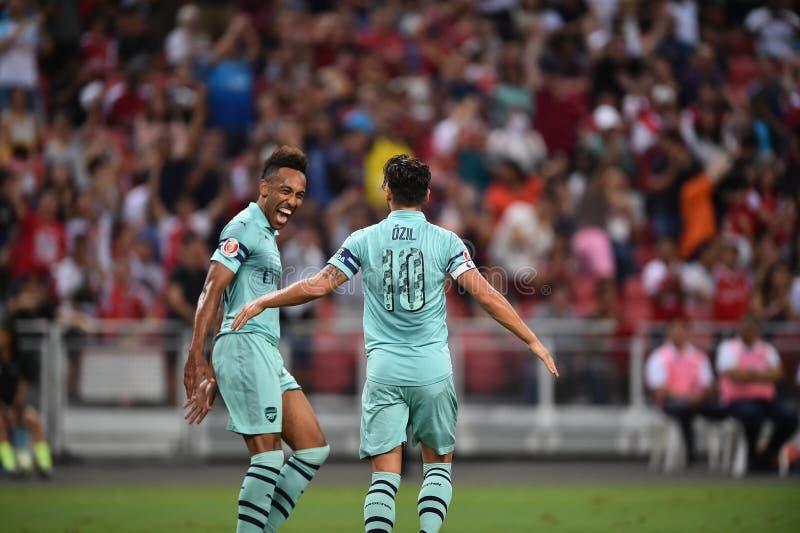 Kallang-Singapore-28Jul2018: Den Mesut Ozil 10 spelaren av arsenalen lurar arkivfoton