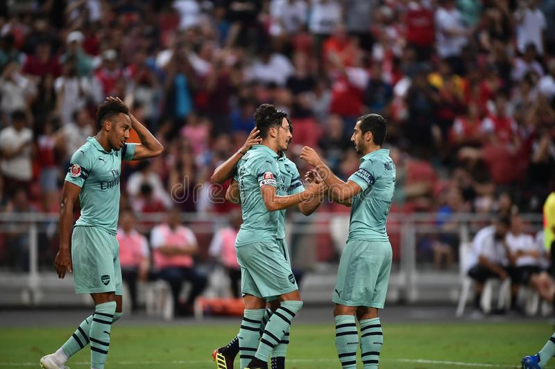 Kallang-Singapore-28Jul2018:Mesut Ozil 10 Player of arsenal con. Gratulation for goal during icc2018 between arsenal against at paris saint-german at national royalty free stock images