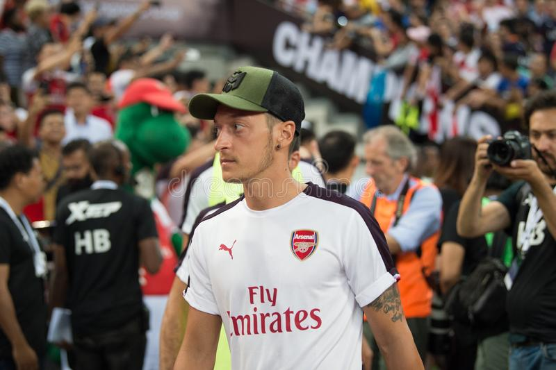 Kallang-Singapore-26Jul2018:Mesut ozil 10 player of arsenal in. Action during icc2018 between arsenal against at atletico de madrid at national stadium royalty free stock images