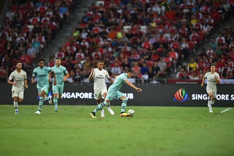 Kallang-Singapore-28Jul2018: Mesut Ozil 10 spelare av arsenalen in royaltyfria bilder