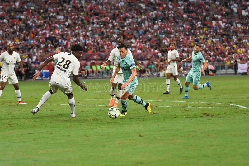 Kallang-Singapore-28Jul2018: Mesut Ozil 10 spelare av arsenalen in royaltyfria foton