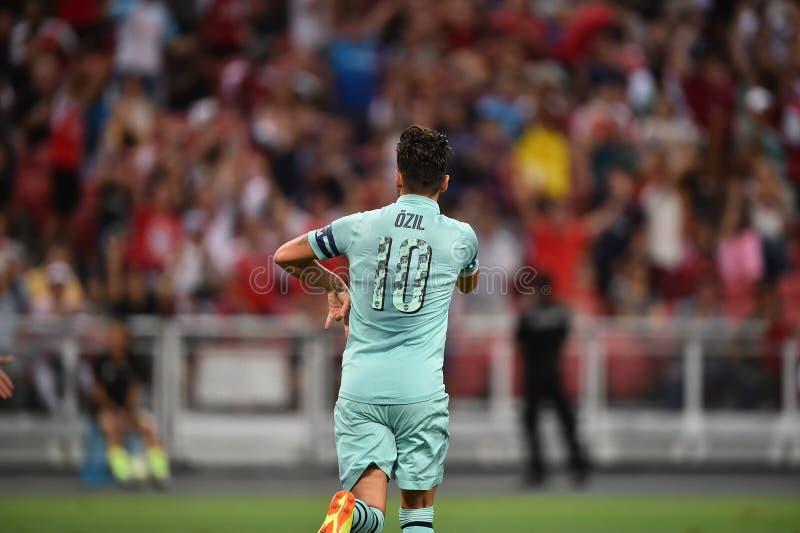 Kallang-Singapore-28Jul2018: Mesut Ozil 10 Speler van arsenaal bedriegt stock fotografie