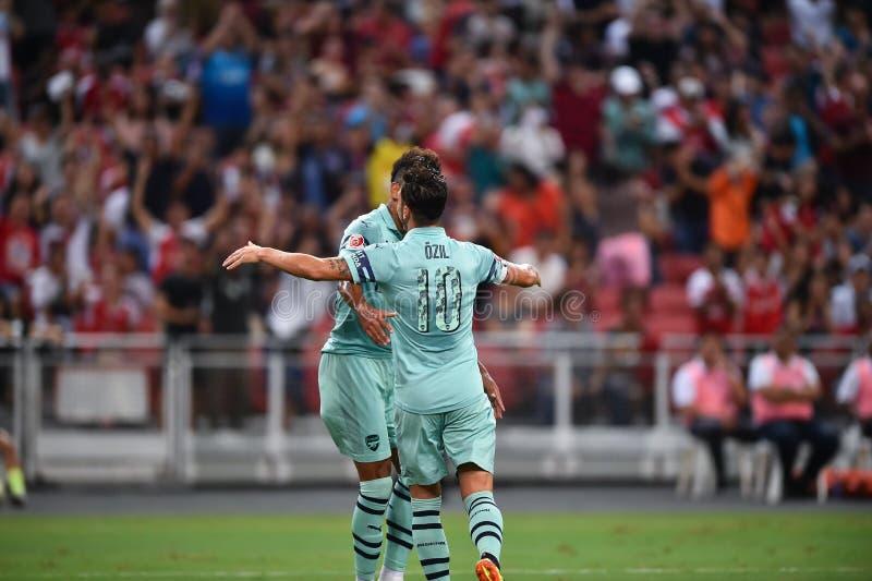 Kallang-Singapore-28Jul2018: Mesut Ozil 10 Speler van arsenaal bedriegt stock afbeelding