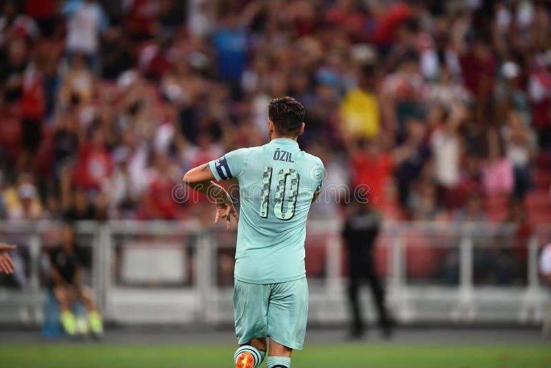 Kallang-Singapore-28Jul2018: Mesut Ozil 10 Speler van arsenaal bedriegt stock afbeeldingen