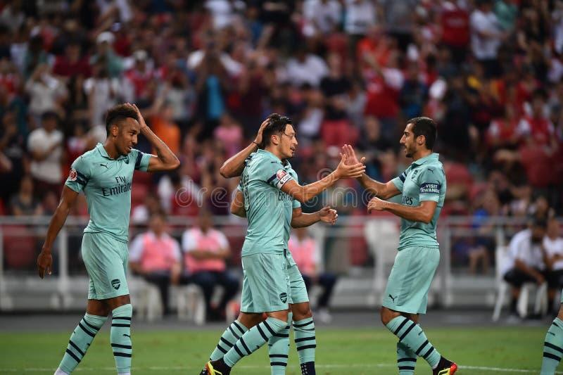 Kallang-Singapore-28Jul2018: Mesut Ozil 10 Speler van arsenaal bedriegt stock foto's