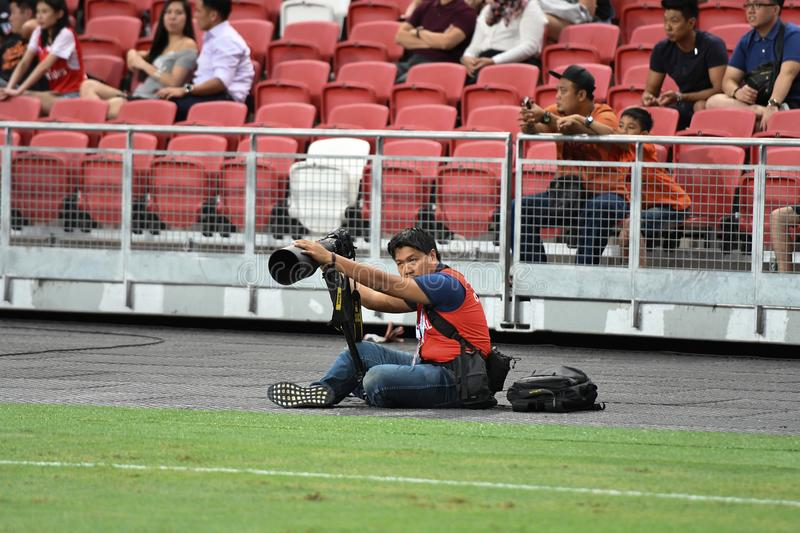 Kallang-Singapore-26Jul2018:Official photographer in action during icc2018 between arsenal against at atletico de madrid royalty free stock images