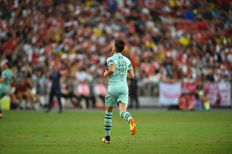 Kallang-Singapur 28 de julio de 2018: Jugador de Mesut Ozil 10 del arsenal adentro fotos de archivo