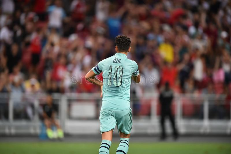 Kallang-Singapur 28 de julio de 2018: Jugador de Mesut Ozil 10 de la estafa del arsenal imagen de archivo