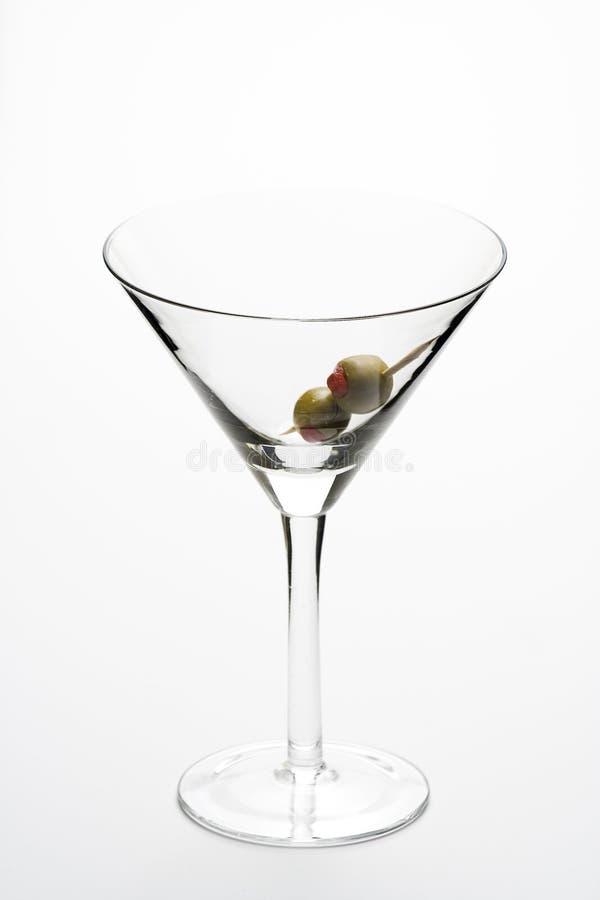 kallt exponeringsglas isolerade martini för coctail arkivbilder