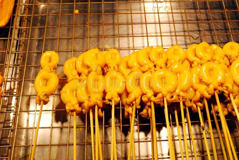 Kalmar mariniert in der Soße stockbild