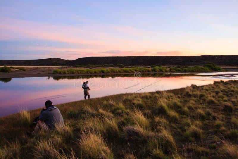 Kalme zonsondergang in Patagonië stock foto's
