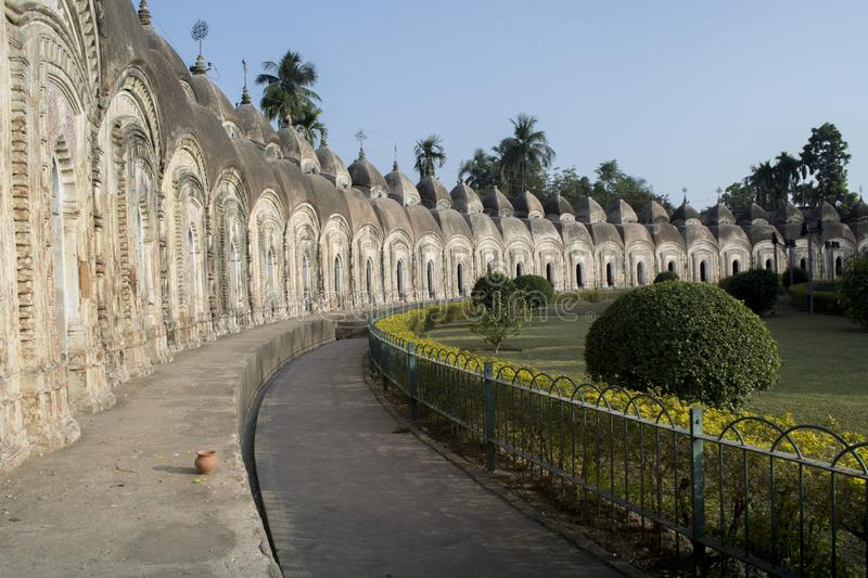 Kalna, Burdwan, India - January 18, 2018: 108 Shiba Temple made by a king. Its a teracotta temple which housed black and white Shi. Va lingo. The temple is in stock image