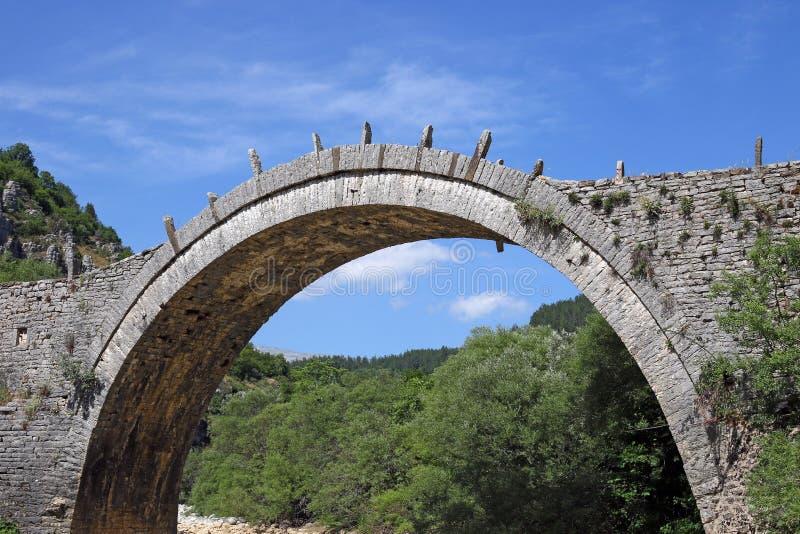 Kalogeriko arched stone bridge Zagoria stock photo