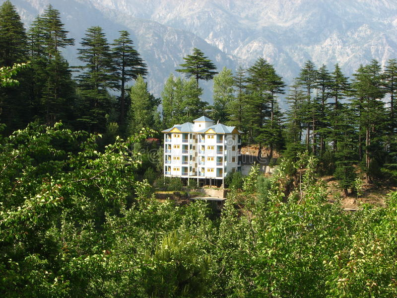 Kalpa Valley, Himachal, Pradesh, India. A white building in the midst of the scenic lushly treed Kalpa Valley, Himachal, Pradesh, India royalty free stock image